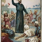 Saint_Francis_Xavier_holding_a_crucifix_surrounded_by_Wellcome_V0031972_resize.th.jpg