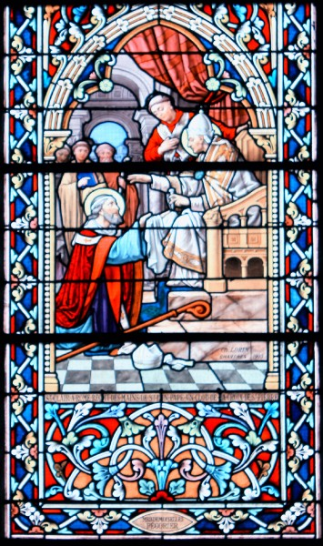 "Saint Clair of Nantes in Rome, receives a nail from the cross of Saint Peter from the hands of Pope Linus. Stained-glass windows of Église Saint-Clair (Réguiny) - Signature of Ch.Lorin, Chartres 1905, gift of Miss Pégorier  <a href=""https://commons.wikimedia.org/wiki/File:%C3%89glise_Saint-Clair_(R%C3%A9guiny)_5993.JPG"" title=""via Wikimedia Commons"" target=""_blank"">XIIIfromTOKYO</a> / <a href=""https://creativecommons.org/licenses/by-sa/3.0"" target=""_blank"">CC BY-SA</a>"