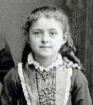 """The photograph is from 1881 (It represents Therese of Lisieux at the age of eight).  <p><a href=""""https://commons.wikimedia.org/wiki/File:TdL-1881.JPG#/media/File:TdL-1881.JPG"""" target=""""_blank""""></a><br>Public Domain, <a href=""""https://commons.wikimedia.org/w/index.php?curid=1888611"""" target=""""_blank"""">Link</a></p>"""